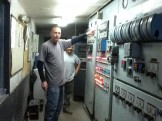 Worker Pointing at Controls